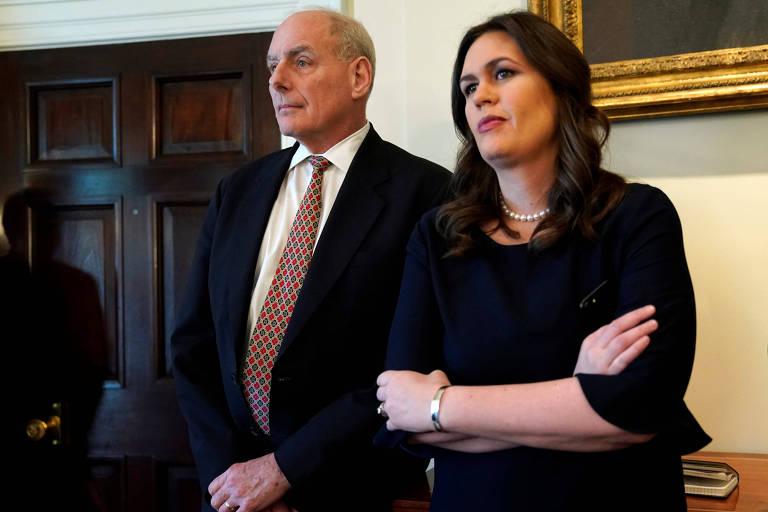 John Kelly, chefe de gabinete de Trump, e Sarah Sanders, porta-voz da Casa Branca, durante o anúncio de tarifas para aço e alumínio