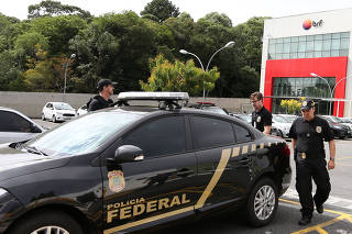 Federal Police officers leave the headquarters of the meatpacking company BRF SA in Curitiba
