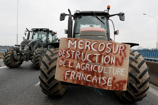 French farmers drive their tractors on the A7 highway to protest changes in underprivileged farm area?s mapping and against Mercosur talks, in PIerre-Benite