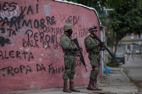 Soldiers of the Armed Forces, backed by armoured vehicles, aircraft and heavy engineering equipment, take part in an operation in the violence-plagued favela of Vila Kennedy, in Rio de Janeiro, Brazil, on March 7, 2018.