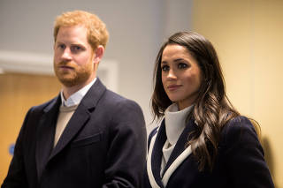 Britain's Prince Harry and his fiancee Meghan Markle watch Coach Core apprentices taking part in a training masterclass exercise at Nechells Wellbeing Centre in Birmingham