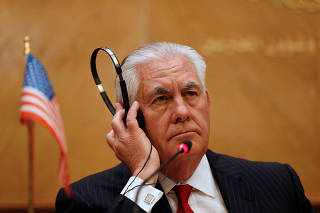 U.S. Secretary of State Rex Tillerson listens to the translation during a news conference with Jordanian Foreign Minister Ayman Safadi in Amman