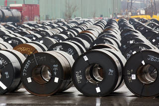 Stored rolls of steel are seen outside the ArcelorMittal Dofasco plant in Hamilton