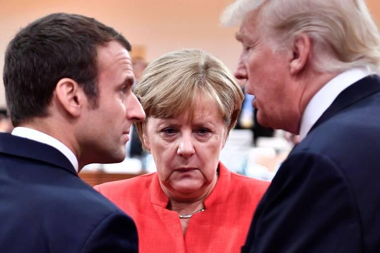 O presidente francês, Emmanuel Macron (à esq.), a chanceler alemã, Angela Merkel, e o presidente dos EUA, Donald Trump