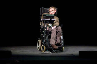 FILE PHOTO: Professor of mathematics at Cambridge University Stephen W. Hawking discusses theories on the origin of the universe in a talk in Berkeley