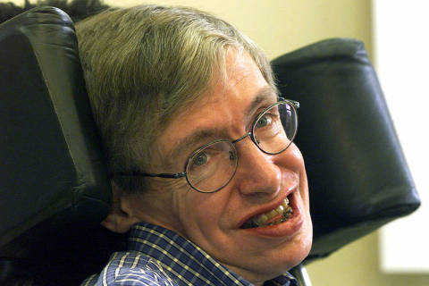 FILE - In this Wednesday, July 21, 1999 file photo Professor Stephen Hawking smiles during a news conference at the University of Potsdam, near Berlin, Germany. Hawking, whose brilliant mind ranged across time and space though his body was paralyzed by disease, has died, a family spokesman said early Wednesday, March 14, 2018.(AP Photo/Markus Schreiber, File) ORG XMIT: TH107