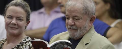 Former Brazilian President Luiz Inacio Lula da Silva reads his book during its launch, in Sao Paulo, Brazil, Friday, March 16, 2018. In his book entitled