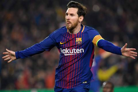 TOPSHOT - Barcelona's Argentinian forward Lionel Messi celebrates scoring his team's third goal during the UEFA Champions League round of sixteen second leg  football match between FC Barcelona and Chelsea FC at the Camp Nou stadium in Barcelona on March 14, 2018. / AFP PHOTO / LLUIS GENE