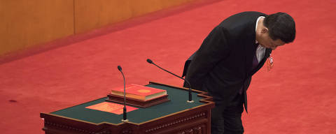 Chinese President Xi Jinping bows after taking the oath of office after being formally re-elected to a second term as China's President during a plenary session of China's National People's Congress at the Great Hall of the People in Beijing, Saturday, March 17, 2018. Xi was reappointed Saturday as China's president with no limit on the number of terms he can serve. The ceremonial National People's Congress voted unanimously for Xi's second five-year term as president. (AP Photo/Andy Wong) ORG XMIT: XAW133