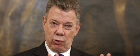 Colombia's President Juan Manuel Santos addresses the media after talks with Austrian President Alexander van der Bellen at the Hofburg palace in Vienna, Austria, Friday, Jan. 26, 2018. (AP Photo/Ronald Zak) ORG XMIT: XRZ119
