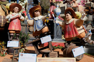 Figures representing Russian President Vladimir Putin, U.S. President Donald Trump, and North Korean leader Kim Jong Un are depicted at a monument during the Fallas festival in Valencia