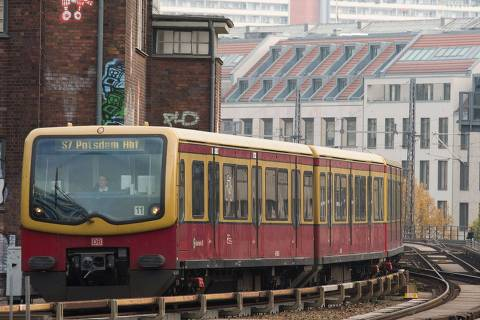 (FILES) This file photo taken on November 5, 2014 shows a suburban S-Bahn train pulling into a station in downtown Berlin.