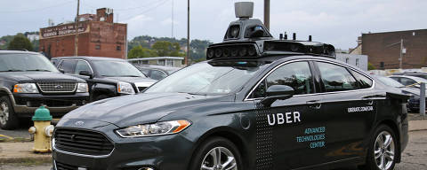 A self driving Uber car drives down River Road on Pittsburgh's Northside Wednesday, Sept. 14, 2016. On Wednesday, a fleet of self-driving Ford Fusions began picking up Uber riders who opted to participate in a test program. While the vehicles are loaded with features that allow them to navigate on their own, an Uber engineer sits in the driver's seat and can seize control if things go awry.  (AP Photo/Gene J. Puskar) ORG XMIT: PAGP113