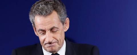 (FILES) In this file photo taken on November 20, 2016 in Paris, former French president and candidate for the right-wing Les Republicains party primaries ahead of the 2017 presidential election, Nicolas Sarkozy delivers a speech to concede defeat in the first round of the rightwing presidential primary. 