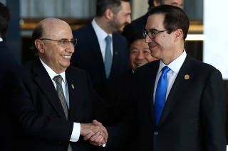 U.S. Secretary of the Treasury Steven Mnuchin and Brazil's Finance Minister Henrique Meirelles shake hands after posing for the official photo at the G20 Meeting of Finance Ministers in Buenos Aires