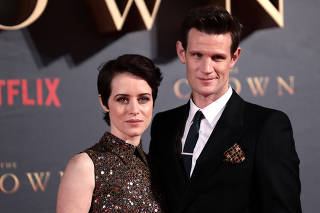 FILE PHOTO: Actors Claire Foy, who plays Queen Elizabeth II, and Matt Smith who plays Philip Duke of Edinburgh, attend the premiere of
