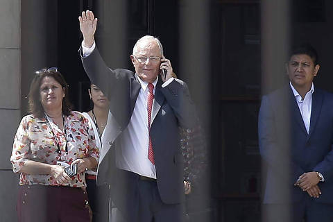 Peru's President Pedro Pablo Kuczynski waves from the Government Palace also known as the House of Pizarro, in Lima, Peru, Wednesday, March 21, 2018. The embattled Peruvian leader has offered his resignation to Congress ahead of a scheduled vote on whether to impeach the former Wall Street investor, according to a presidential aide. (AP Photo/Martin Mejia) ORG XMIT: LIM110