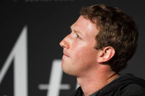 (FILES) In this file photo taken on September 18, 2013 Facebook Founder and CEO Mark Zuckerberg speaks during an interview session with The Atlantic at the Newseum in Washington, DC. Zuckerberg, breaking his silence over the data scandal roiling the social network, acknowledged on March 21, 2018, the company made