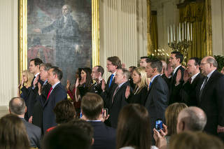 Senior staffers in President Donald Trump?s administration are sworn in, at the White House in Washington.