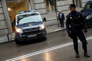 A police van beleived to be carrying some of the five Catalan politicians ordered to be jailed pending their trial for rebellion leaves the Supreme Court in Madrid