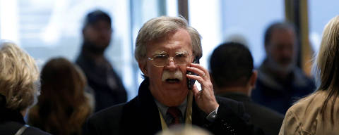 FILE PHOTO: Former U.S. Ambassador to the United Nations John Bolton speaks on a mobile phone as he arrives for a meeting with U.S. President-elect Donald Trump at Trump Tower in New York, U.S., December 2, 2016.   REUTERS/Mike Segar/File Photo ORG XMIT: TOR476