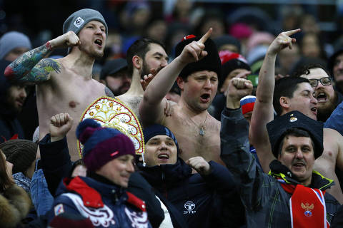Russia supporters gesture on the stands during an international friendly soccer match between Russia and Brazil at the Luzhniki stadium in Moscow, Russia, Friday, March 23, 2018. (AP Photo/Alexander Zemlianichenko) ORG XMIT: XAF133
