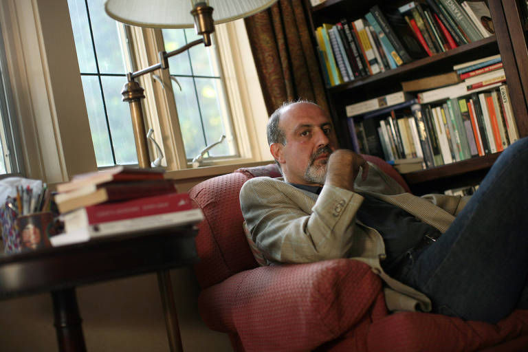 Nassim Nicholas Taleb at his home in Larchmont, N.Y., in September 2009. Taleb, a trader, said that the financial system was riskier than last fall and that government aid had led investors to expect banks to be bailed out. Twelve months after the bankruptcy of Lehman Brothers and the 11th-hour rescue of AIG, Wall Street lives on. The financial industry has restructured only around the edges. Only a handful of hedge funds have closed their doors. Financial stocks have soared since their lows this winter. The Obama administration has proposed regulatory reforms, but even their backers say they face a long and difficult road in Congress. (Michael Appleton/The New York Times)