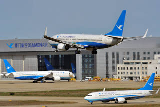 Boeing airplane of Xiamen Airlines lands at the Fuzhou Changle International Airport in Fuzhou
