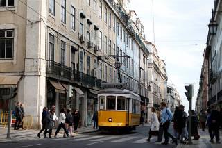A tram runs in downtown Lisbon