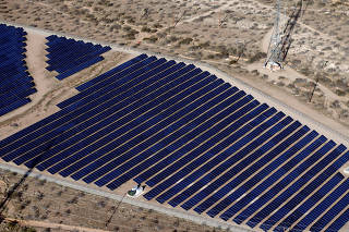FILE PHOTO:    Array of solar panels is seen in the desert in Victorville, California