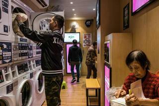 Customer collect clothes at a laundry shop  in Hong Kong.
