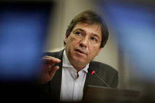 CEO of Eletrobras, the state-owned Brazilian power company, Wilson Ferreira Junior gestures during a news conference in Brasilia