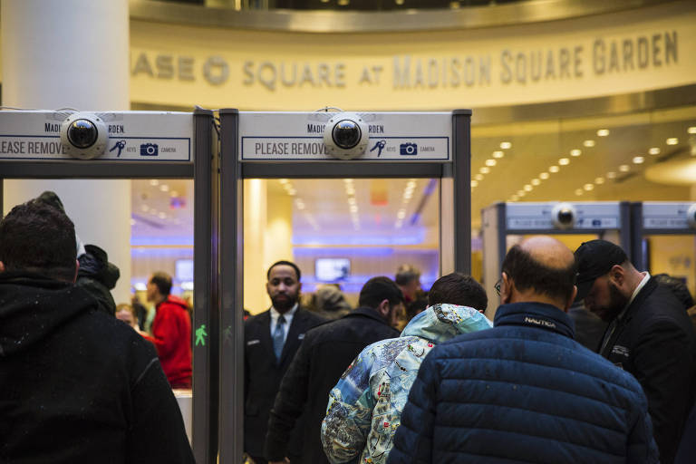 Fans arriving for the Big East men?s basketball conference tournament pass through scanners at Madison Square Garden in Manhattan, March 7, 2018. The arena has quietly used facial-recognition technology to bolster security and identify those entering the building, according to multiple people familiar with security procedures. (Benjamin Norman/The New York Times)
