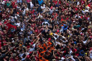 Former Brazilian President Luiz Inacio Lula da Silva is carried by supporters in front of the metallurgic trade union in Sao Bernardo do Campo
