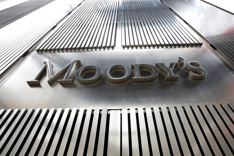 FILE PHOTO: A Moody's sign is displayed on 7 World Trade Center, the company's corporate headquarters in New York, February 6, 2013. REUTERS/Brendan McDermid/File Photo ORG XMIT: HFSMSH03
