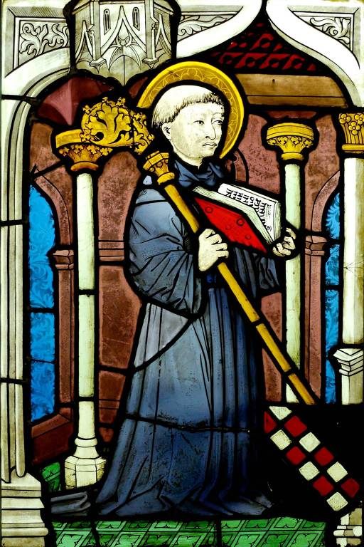 Vitral do santo Bernardo de Claraval. Na imagem, o homem segura um livro e um bastão