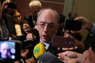Petrobras CEO Pedro Parente talks with the media during Brazil's 15th round of oil fields auctions, in Rio de Janeiro