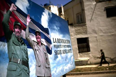 A poster of Fidel Castro and Cuba's President Raul Castro stands in Havana, Cuba, Wednesday, April 18, 2018. The Cuban government on Wednesday selected 57-year-old First Vice President Miguel Mario Diaz-Canel Bermudez as the sole candidate to succeed Raul Castro in a transition aimed at ensuring that the country's single-party system outlasts the aging revolutionaries who created it. (AP Photo/Ramon Espinosa) ORG XMIT: XRE102