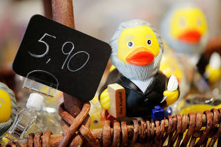 FILE PHOTO: A rubber duck depicting German philosopher Karl Marx is for sale at the price of 5.90 euro at a souvenir shop in his hometown in Trier