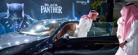 VIPs arrive for ?Black Panther,? the first public movie screening in Saudi Arabia following a decades-long ban, in Riyadh, April 18, 2018. Saudi officials hope that expanding entertainment options will not only allow citizens to have more fun, but also help the economy by keeping at home some of the money that Saudis spend on entertainment abroad. (Tasneem Alsultan/The New York Times) ORG XMIT: XNYT123
