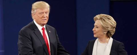 Republican U.S. presidential nominee Donald Trump and Democratic U.S. presidential nominee Hillary Clinton shake hands at the conclusion of their presidential town hall debate at Washington University in St. Louis, Missouri, U.S., October 9, 2016.   REUTERS/Lucy Nicholson  ORG XMIT: STLHB103