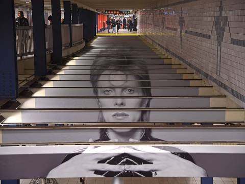 TOPSHOT - A David Bowie art installation is seen at the Broadway-Lafayette subway station on April 19, 2018 in New York City.