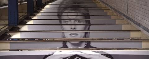 TOPSHOT - A David Bowie art installation is seen at the Broadway-Lafayette subway station on April 19, 2018 in New York City. The subway-wall-sized images of Bowie-inspired art, is in collaboration with Spotify and the Brooklyn Museum's current exhibition