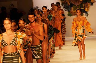 Brazilian singer Annita performs as models present creations from the Agua de Coco por Liana Thomaz collection during the Sao Paulo Fashion Week