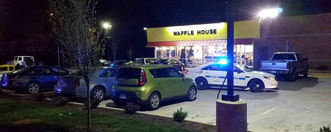 A police vehicle sits parked at the scene of a fatal shooting at a Waffle House restaurant near Nashville, Tennessee, U.S., April 22, 2018.    Metro Nashville Police Department/Handout via REUTERS   ATTENTION EDITORS - THIS IMAGE WAS PROVIDED BY A THIRD PARTY ORG XMIT: TOR432
