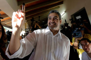 Paraguayan presidential candidate Mario Abdo Benitez of the Colorado Partido shows his inked finger before casting his vote at a polling station during the election in Asuncion