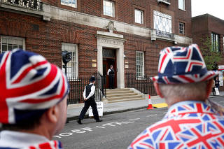 Supporters of the royal family stand outside the Lindo Wing of St Mary's Hospital after Britain's Catherine, the Duchess of Cambridge, was admitted after going into labour ahead of the birth of her third child, in London