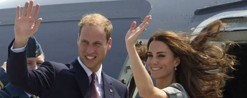 ORG XMIT: ONCR108 Prince William and Kate, the Duke and Duchess of Cambridge, wave as they board their plane as they leave Ottawa, Ontario , en route to Montreal as they continue their Royal Tour of Canada Saturday, July 2, 2011. (AP Photo/Charlie Riedel)