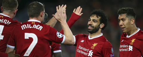 Liverpool's Mohamed Salah, 2nd right, celebrates with his teammates their side's third goal during the Champions League semifinal, first leg, soccer match between Liverpool and AS Roma at Anfield Stadium, Liverpool, England, Tuesday, April 24, 2018. (AP Photo/Dave Thompson) ORG XMIT: XAF136