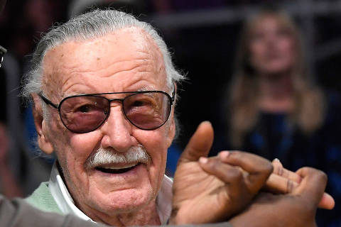 FILE - In this Oct. 27, 2017 file photo, famed comic book creator Stan Lee appears at an NBA basketball game between the Los Angeles Lakers and the Toronto Raptors, in Los Angeles. A Chicago masseuse is suing Marvel Comic's Stan Lee, accusing him of inappropriate behavior during two massages in 2017. Maria Carballo filed the lawsuit Monday, April 24, 2018, seeking more than $50,000 in punitive damages and attorney fees from the 95-year-old comic book writer. (AP Photo/Mark J. Terrill File) ORG XMIT: CER202